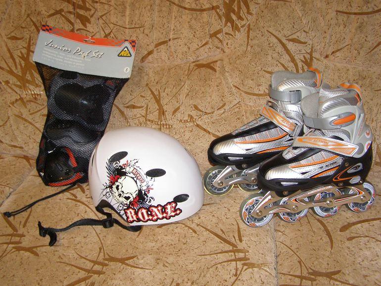 Продам роликовые коньки и защиту