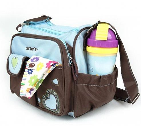 e6feaec7acc4 В основе сумочки Сarters для мамы и малыша - прочная, водонепроницаемая  ткань, отлично выдерживающая испытание временем. Она не линяет, не выгорает  от ...
